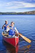 Family canoe trip Stock Photos