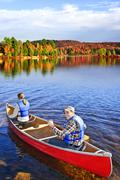 canoing in fall - stock photo