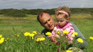 Stock Video Footage of Dad & Daughter Watching Flowers