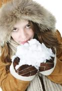 Stock Photo of playful winter girl holding snow