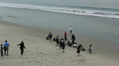 Children diggin on the beach Stock Footage