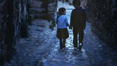 Children walking in the alley Stock Footage