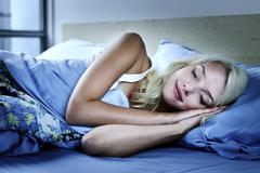 Stock Photo of woman sleeping in bed