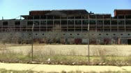 Detroit's abandoned and deteriorating Packard Auto Plant drive-by Stock Footage