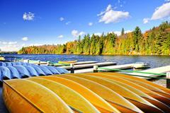 canoe rental on autumn lake - stock photo
