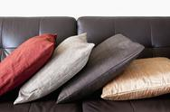 Stock Photo of cushions on leather sofa