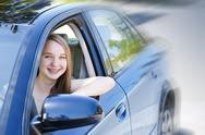Stock Photo of teenage girl learning to drive