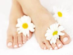 female feet with pedicure - stock photo