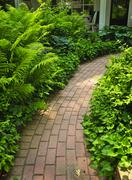 Stock Photo of brick path in landscaped garden