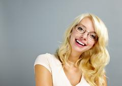 Happy woman wearing glasses Stock Photos