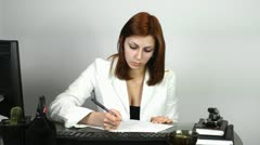 Girl Secretary fills in the questionnaire Stock Footage