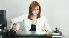 Woman in the office, holds together paper stapler Stock Footage
