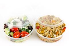 Prepared salads in takeout containers Stock Photos