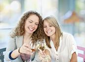 Stock Photo of women toasting with white wine