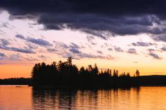 dramatic sunset at lake - stock photo