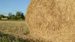 Closeup straw bale roll agriculture field heavy truck Stock Footage