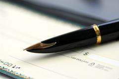 Checkbook pen Stock Photos