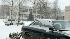 Cars standing outdoor snowstorm snow fall winter Stock Footage
