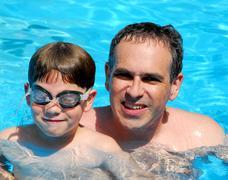 father son pool - stock photo
