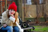 Girl on bench Stock Photos