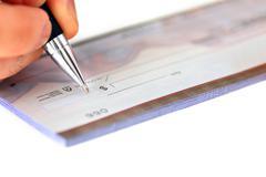 Writing a check Stock Photos
