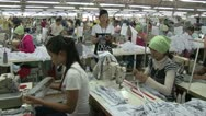 Stock Video Footage of Garment Factory: Female garment workers with supervisor watching