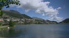 St. Moritz villagee behind Lake St. Moritz Stock Footage