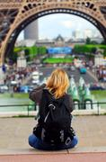 tourist at eiffel tower - stock photo