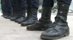 Security guard boots in line Stock Footage