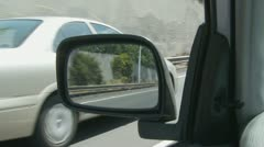 Reflection in car mirror of 24 wheel Australian lorry - stock footage
