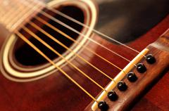 Stock Photo of old guitar close up