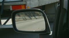 Large Artic lorries reflected in car mirror - stock footage