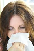 woman with flu or allergy - stock photo