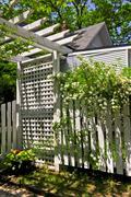 White trellis in a garden Stock Photos