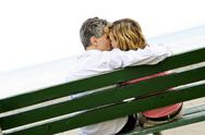 Stock Photo of mature romantic couple on a bench