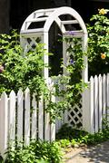 white arbor in a garden - stock photo