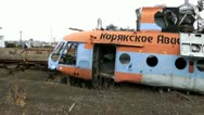 Stock Video Footage of The old Soviet MI-8 helicopter lies forever on an aviation cemetery