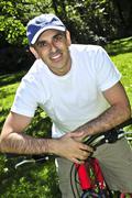 Man riding a bicycle Stock Photos