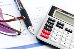 Tax calculator pen and glasses Stock Photos