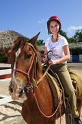 girl riding horse - stock photo