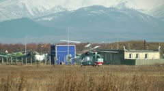 The small helicopter with two screws left a hangar and goes on a concrete path Stock Footage