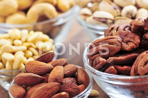 Stock photo of bowls of assorted nuts