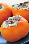 Persimmons Stock Photos