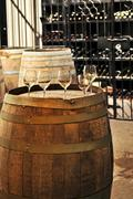 wine  glasses and barrels - stock photo