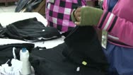 Stock Video Footage of Textile Garment Factory: Female garment workers sort completed garments