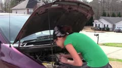 Looking Under Hood Stock Footage
