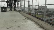 Workman on a building site laying concrete in Timelapse Stock Footage