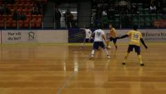 Falling in indoor football/soccer Stock Footage