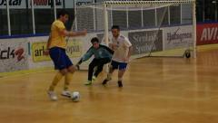 Playing indoor soccer/football Stock Footage