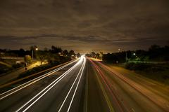 Los Angeles Freeway Traffic At Night Stock Photos